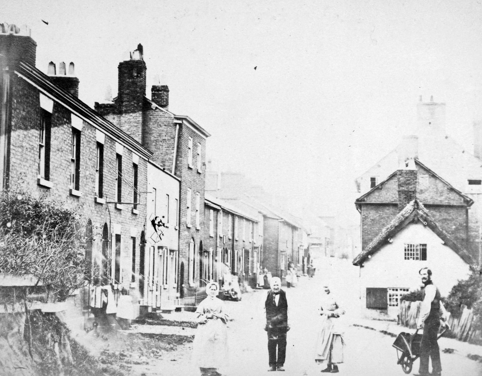 King Street, Knutsford with people in the road.