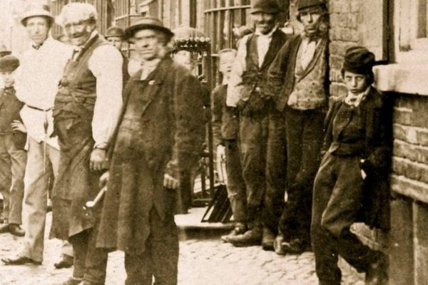 A group of businessmen on King Street in Victorian Era